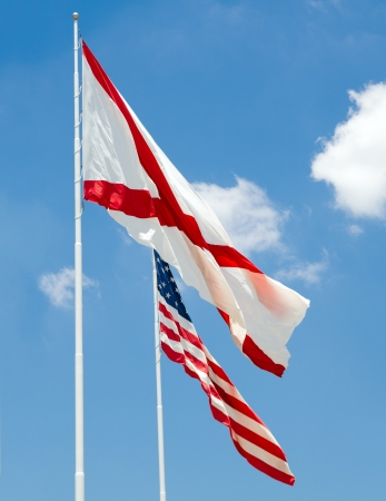 u s  flag: Alabama state flag and U S  flag together under cloudy blue sky