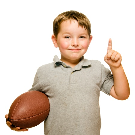 Child with football celebrating by showing that he s Number 1 isolated on white photo