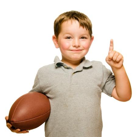 numero uno: Niño con el fútbol celebrando demostrando que s Número 1 aislado en blanco Foto de archivo