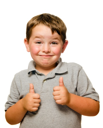 thumb's up: Portrait of confident child showing thumbs up isolated one white
