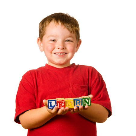 Preschool education concept with child holding blocks that spell out  learn