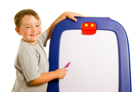 room for text: Child pointing at dry erase board with room for your text