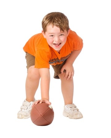 touchdown: Child playing with American football isolated on white