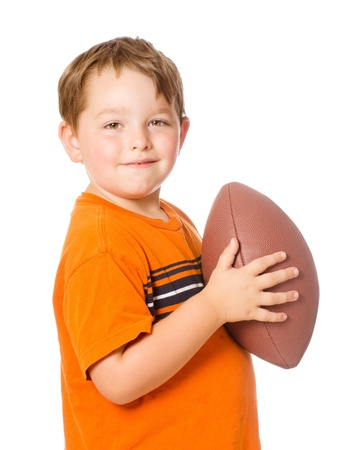 american content: Child playing with American football isolated on white