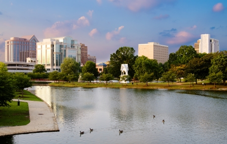 Cityscape scene of downtown Huntsville, Alabama, from Big Spring Park at sunset photo