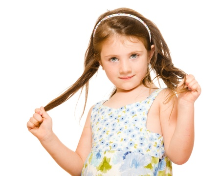 barber scissors: Hair care concept with portrait of young girl holding her long hair isolated on white Stock Photo