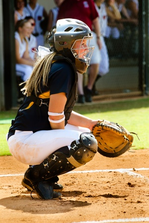Young teen girl playing softball in organized game Stock Photo