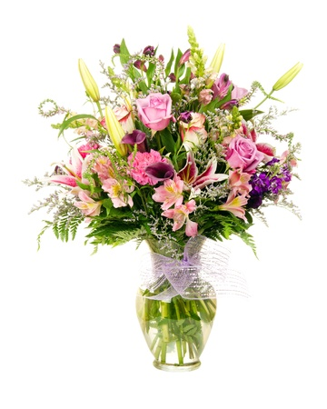 Colorful florist-made floral flower arrangement bouquet with lavender roses, calla lilies, alstroemeria, carnations, isolated on white Stock Photo