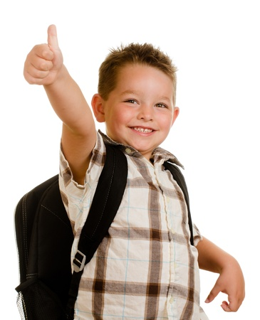 Happy schoolboy wearing backpack and giving thumbs up isolated on white Stock Photo