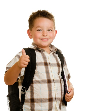 Happy schoolboy wearing backpack and giving thumbs up isolated on white photo