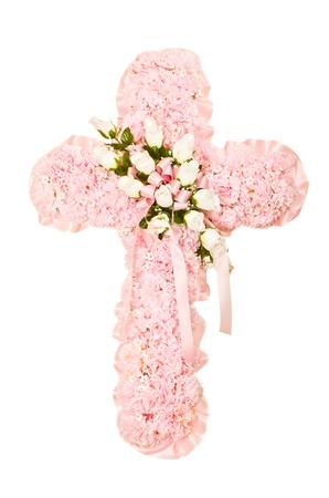 Silk funeral floral arrangement in shape of cross photo