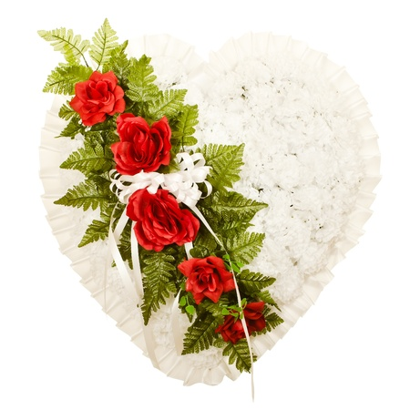 Silk funeral flower arrangement in broken heart design photo