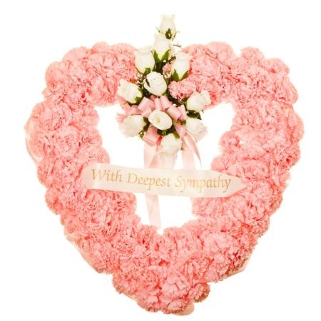Silk funeral flower arrangement in heart design