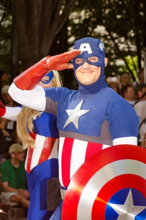 ATLANTA - Sept. 1: A comic book fan dressed as Captain America salutes at the annual DragonCon parade on Sept. 1, 2012. DragonCon bills itself as the largest Sci-Fi convention in the world.