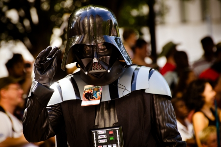 ATLANTA - Sept. 1: A Star Wars fan dressed as Darth Vader marches in the annual DragonCon parade on Sept. 1, 2012. DragonCon bills itself as the largest Sci-Fi convention in the world. Stock Photo - 15055001