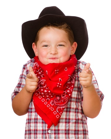 cowboy up: Child dressed up as cowboy playing isolated on white