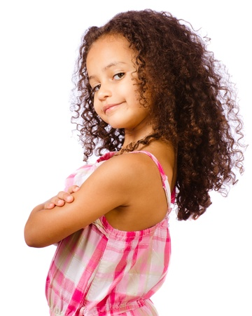Portrait of pretty African-American mixed race child against white background