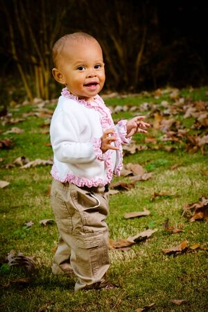 Outdoor portrait of African American toddler during late fall or winter photo