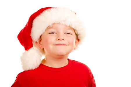 Portrait of  happy child wearing Santa hat photo