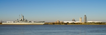 alabama: Panoramic of Mobile, Alabama, skyline with U.S.S. Alabama in foreground on Mobile Bay