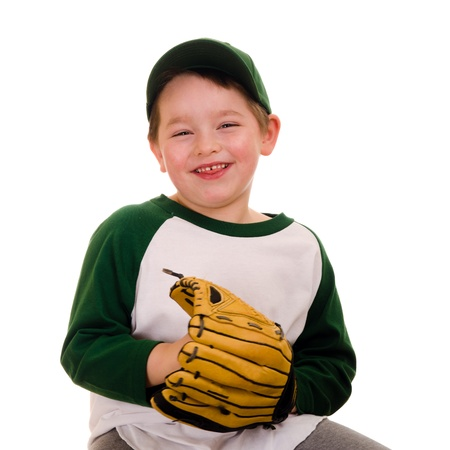 Cute young baseball or t-ball player isolated on white Stock Photo - 17890429