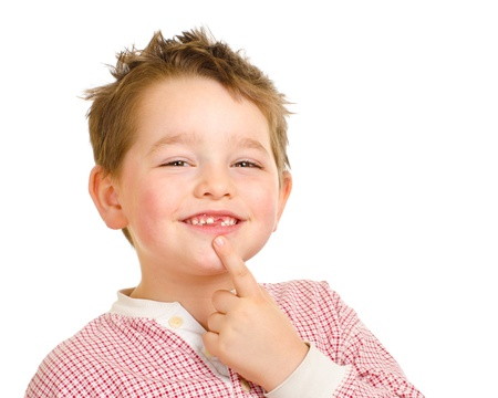 Child showing off his lost teeth isolated on white photo
