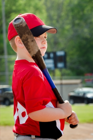 baseball caps: Portrait of child preparing to bat during organized league baseball game