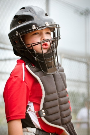 ballplayer: Portrait of child with catcher s equipment on during baseball game