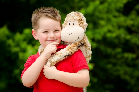 Portrait of boy playing with his stuffed animal pet Stock Photo - 19377387