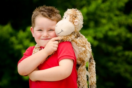 Portrait of boy playing with his stuffed animal pet Stock Photo - 19377389