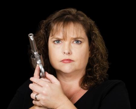 loaded: Woman holding loaded gun