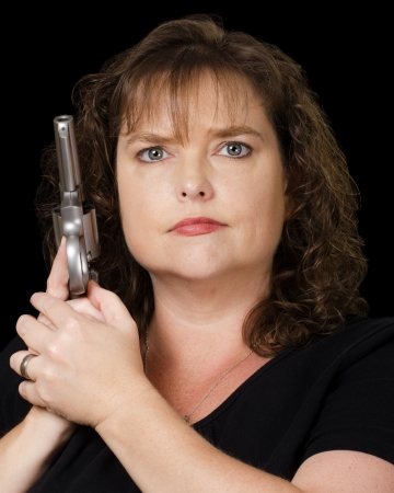 ownership and control: Woman holding loaded gun