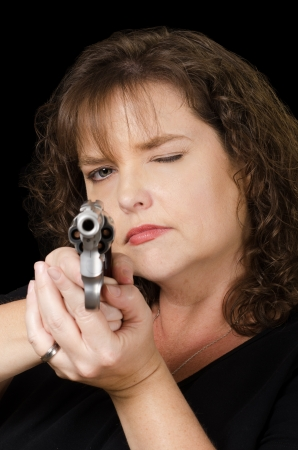 Woman holding loaded gun photo