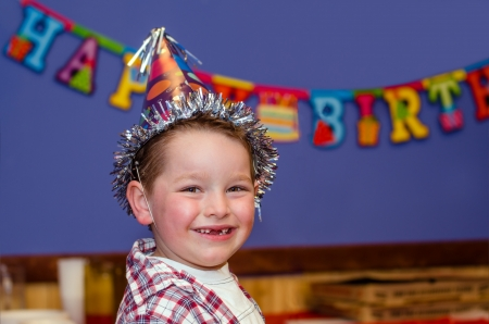 birthday party kids: Portrait of child enjoying his birthday party with copy space Stock Photo