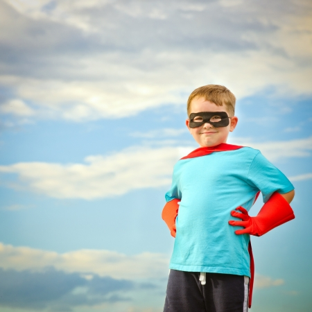 Child pretending to be a superhero with copy space Stock Photo
