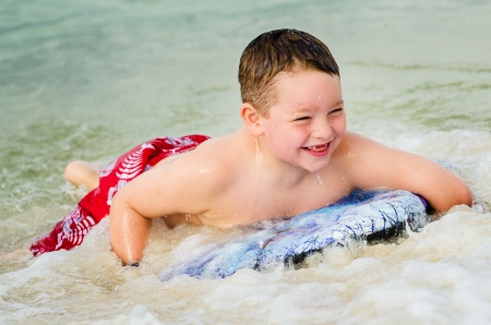 bodyboard: Child surfing on bodyboard at beach