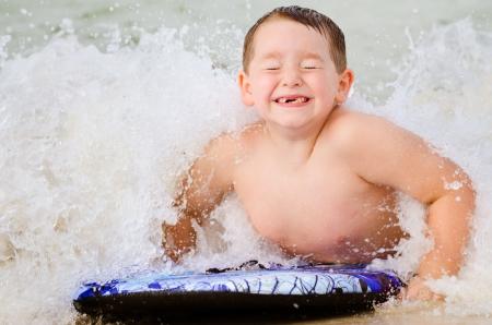 boogie: Child surfing on bodyboard at beach