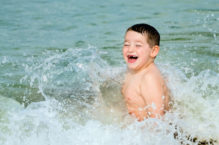 panama city beach: Child playing in surf at beach Stock Photo