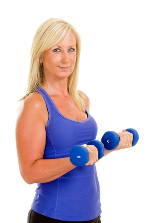 Healthy middle aged woman exercising with dumbbells