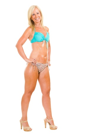 Healthy middle aged woman wearing bikini isolated on white photo