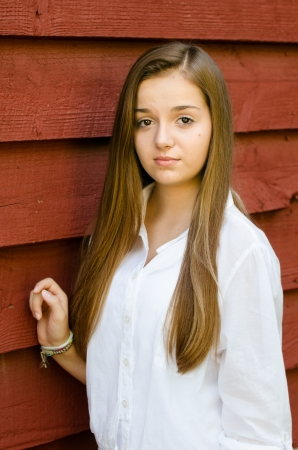 Outdoor portrait of pretty, young teen girl outdoors photo