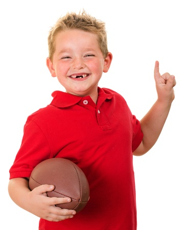 Portrait of happy child with football isolated on white photo