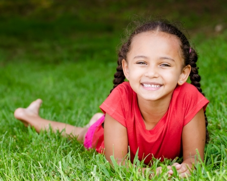 diversity children: Summer portrait of pretty mixed race girl outdoors in natural setting