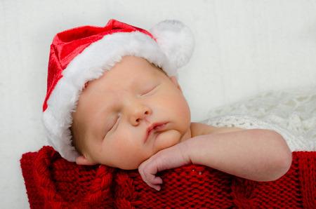wearing santa hat: Cute newborn infant wearing santa hat for christmas holiday