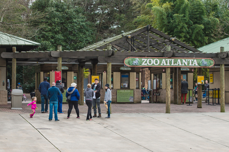 roughly: ATLANTA - DECEMBER 26, 2013  Visitors waiting to enter Zoo Atlanta   The zoo houses more than 1,500 animals and welcomed roughly 866,000 visitors a year