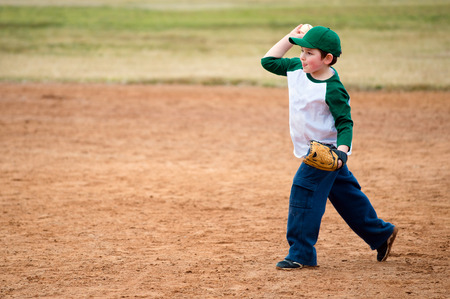 child ball: Boy throws baseball during practice