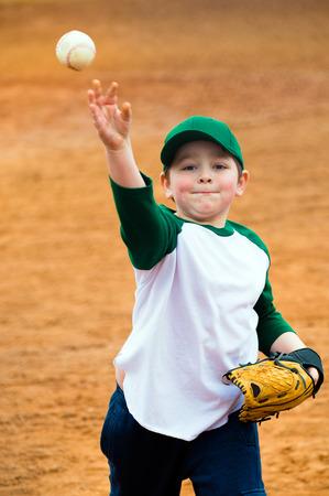 ballplayer: Boy throws baseball during practice