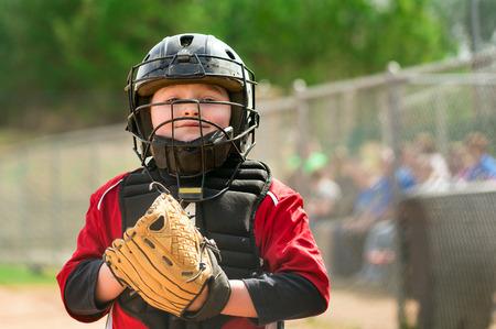 ballplayer: Portrait of child baseball player wearing catcher gear Stock Photo