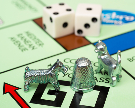 Monopoly game and board pieces Editorial