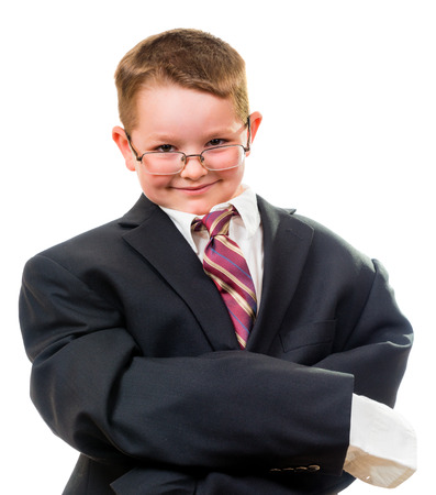 Serious child wearing suit that is too big for him Standard-Bild